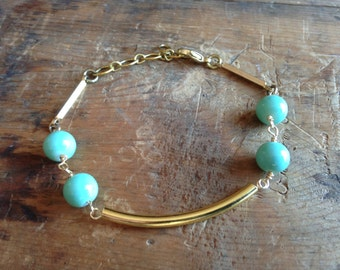 gold tube and turquoise beaded bracelet