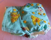 SassyCloth one size pocket diaper with pokemons on turquoise cotton print. Made to order.