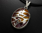 Tribal design Chinese character silver pendant with a red stone