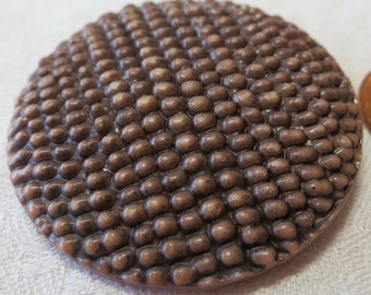 """Large vintage celluloid button, 1.75"""" ins across, chocolate brown, top is like tiny seeds, or small coffee beans.Loop back. PFM13.4-16-8-10."""