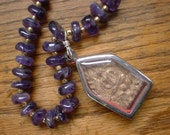 Sacred Buddha Tablet Necklace on Long Amethyst Beads