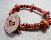 Brown braided leather bracelet with coconut button clasp