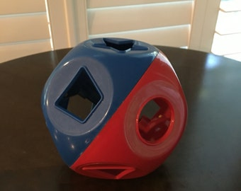 Tupperware Puzzle Ball Sorter Toy for Tots shape o