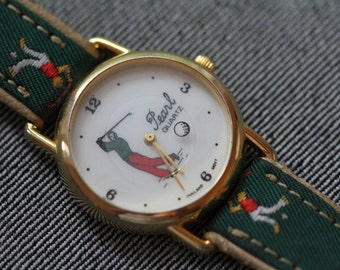 Vintage Golfers Watch with matching strap and rotating golf ball seconds hand