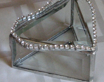 Lots of sparkle and glam with this beveled glass box with a heart shaped lid with string of crystals