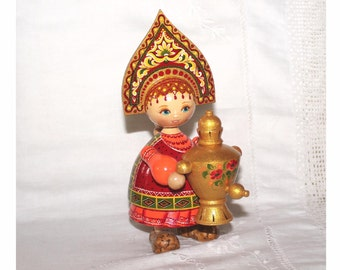 Traditional Russian wooden doll with Samovar and Kokoshnik headdress. Signed to base