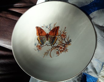 A Vintage Decorative Wall Plate, A White Ceramic Plate with Elegant Monarch Butterfly design transfer print decal with gold leaf trim