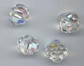 Eight  vintage Swarovski crystal beads - Art. 5300/39 - 11 mm - crystal AB