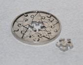 Coin cut puzzle. 12 pcs. 5 Czech Krones