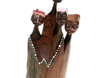 HAND CARVED African Figures - Figures carved from one wooden piece. Four figures with amazing detail. Wonderful African Art piece.