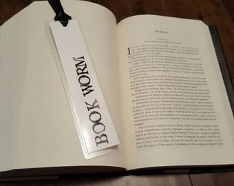 Laminated book worm reading bookmark