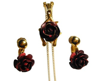 Rose necklace and earrings set, 1980s dark red enameled rose over gold tone wishbone pendant on chain with matching rose clip on earrings