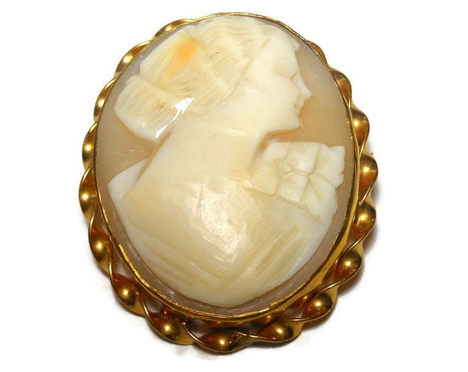 1940s shell cameo brooch, signed 12K 1/20 LSP, gold filled, carved woman with flower on shoulder, cream colored, twisted ribbon edging, oval