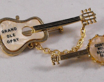 Set of Two Gold Brooches Souvenir Pins Grand Ole Opry Banjo Guitar Country Music Hall Of Fame Faux Mother of Pearl