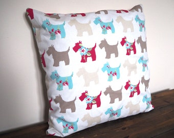 Beautiful Scottie Dog Cushion / Pillow made with white cotton fabric and a multi coloured scottie dog design
