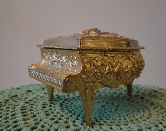 Vintage gold piano trinket box from the 1970s