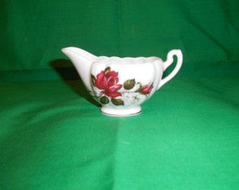 One (1), Individual, Bone China, Creamer, from Royal Dover, in a Rose Pattern.