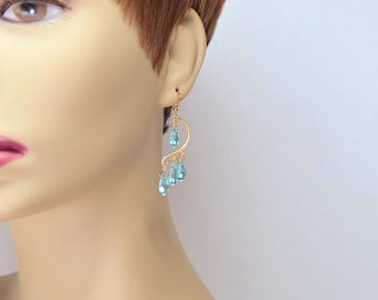 Romantic gold heart earrings with blue Swarovski crystal dangles