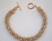 Pearly Peach Spiral Bracelet