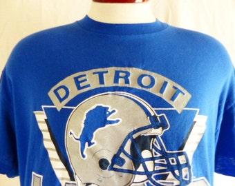 vintage 80's 90's Detroit Lions NFL Football team blue graphic t-shirt crew neck white silver metallic triangle helmet logo trench usa XL