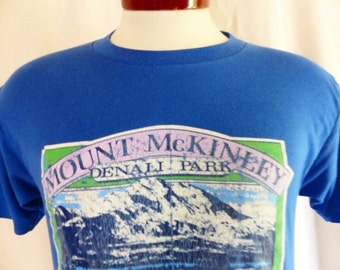 vintage 80's 1983 Mount McKinley Denali Park Alaska blue graphic t-shirt pastel green white lavender landscape nature logo made in usa mediu