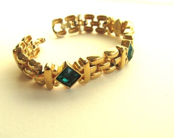 Vintage gold tone metal link bracelet with emerald like green rhinestone accents