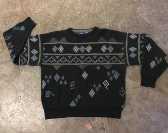 vintage 80s sweater with geometric design and leather accents. men's retro clothing.
