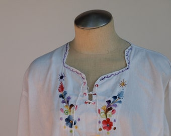 70s long sleeve top with embroidery around the neckline & sleeve