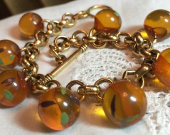Antique Bakelite Button Ball Charm Bracelet