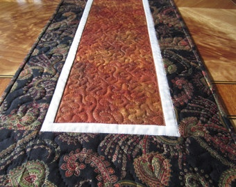 Paisley black and orange quilted table runner