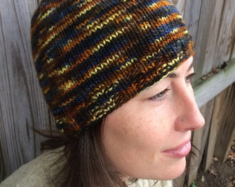 Sunset skullcap made with 100% merino wool in verigated yellows, blue and browns