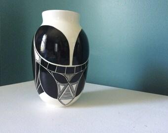 Tall symmetrical pot