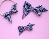 """The """"Mae"""" bow in RifleCo Rosa Floral Navy headband or clip"""