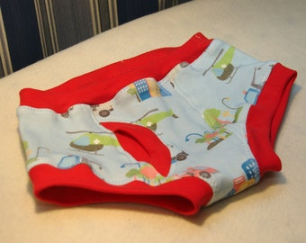 Emergency vehicles organic boys briefs, toddler underwear with firetrucks, police cars, helicopters, and tow trucks. Red or white trim.