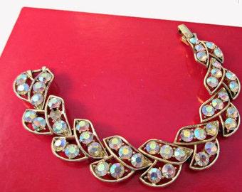 Rhinestone  link Bracelet Aurora Borealis crystals in a  light gold tone metal