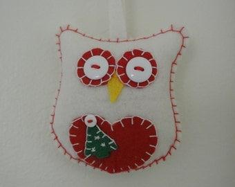 Snowy white Christmas Owl, with Christmas tree.