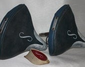 """Two vintage Schwinn Saddles with Monogram and a """"S"""" reflector"""