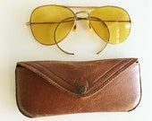 vintage yellow sunglasses with leather case