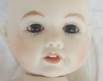 Vintage reproduction of german antique porcelain baby doll 1981