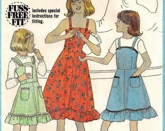 "A Ruffled Hemline, Buttoned Shoulder Straps Sundress and Jumper Pattern: Girls Size 10, Breast 28-1/2"" • Simplicity 8544"