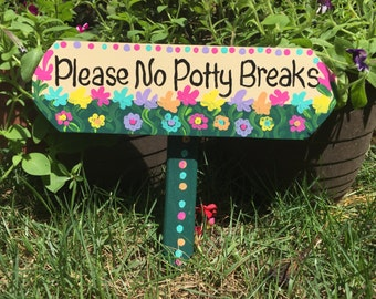No poo sign, no poop, curb your dog, no potty breaks sign, stake