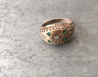 Vintage 14 kt gold dome ring with diamonds and Emeralds.