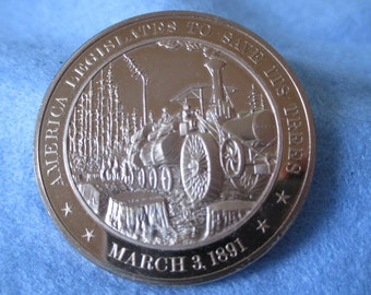 Franklin Mint Solid Bronze coin -America Legislates To Save It's Trees - 1891 -  Add to your collection or start a new collection!