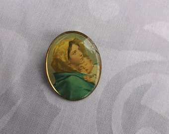 """Oval Pin with image of """"Madonna of the Streets."""" Gift"""