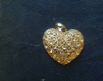 Vintage silver colored metal rhinestone covered heart pendant necklace