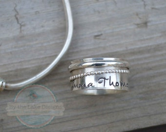hand stamped sterling silver spinner ring with your kids names/ saying stamped on the bottom