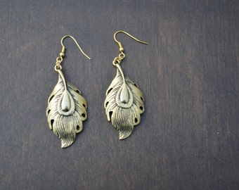 Gold tone metal molded feather earrings