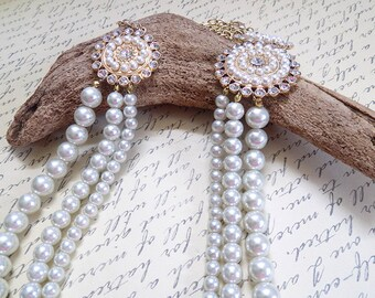 three strand faux pearl necklace