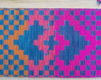 Linked Squares on Checkerboard in Blue and Orange/Magenta
