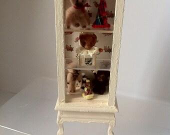 Dolls House Cabinet dressed with handmade teddies